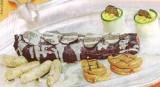 Hazenrug bestoken met truffel, worstjes van kippewit