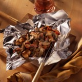 Kippenpakketjes op de barbecue