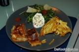Lamsfilet pakje, tomatentapenade, rucola, zondegroogde tomaat, Grana Padano